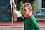 Israel, Tel Aviv, A punk male with pink hair and a Mohican hair cut and an anti police brutality demonstration