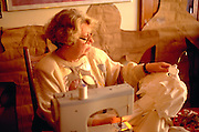 Grandmother age 58 making flower girl wedding dresses.  St Paul  Minnesota USA
