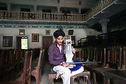 Umesh Mishra, 26 a sarangi virtuoso tunes his instrument before a concert later that night at the Nrityagopal Smriti Mandir, a concert hall in Chandannagar, India
