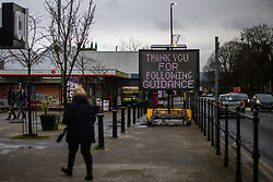 """© Licensed to London News Pictures. 23/12/2020. Bolton, UK. A sign in Bolton reads """" Thank you for following guidance """" in reference to current government guidelines for Tier 3 regions that permit three households per Christmas bubble . Guidance is being presented to encourage people to celebrate Christmas safely and minimise the spread of Coronavirus . Photo credit: Joel Goodman/LNP"""