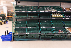 © Licensed to London News Pictures. 21/07/2021. London, UK. Empty shelves in the fresh fruit section of TESCO supermarket in Ealing, West London as the food supply chain is affected by people being pinged by the NHS app to Covid self-isolate. Photo credit: London News Pictures