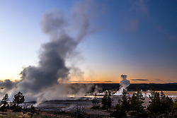 Fountain Geyser eruption at sunset at Lower Geyser Basin of Yellowstone National Park.  This can be a steamy place when the atmospherics and temperature is just right.