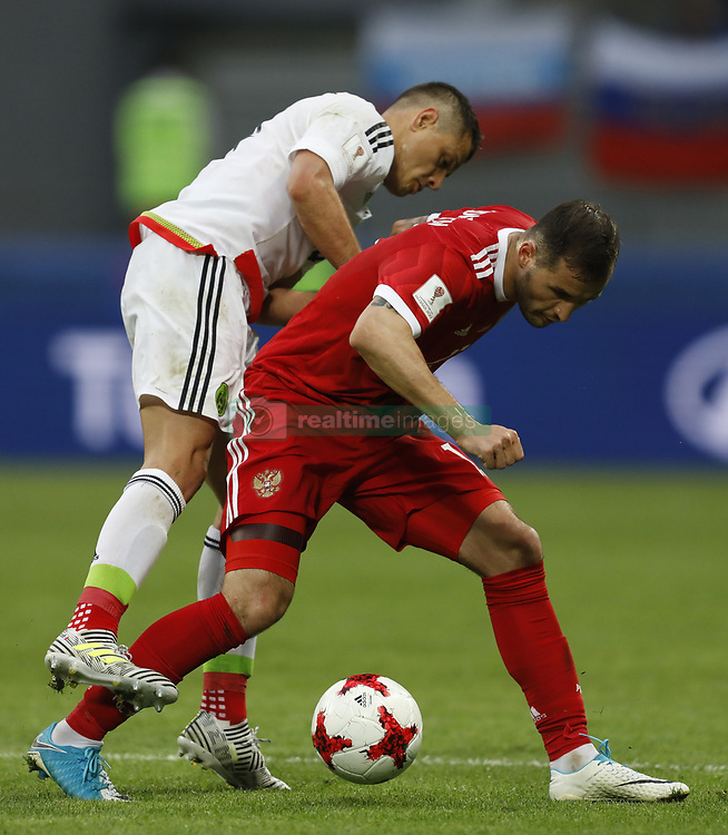 June 24, 2017 - Kazan, Russia - Fedor Kudriashov (R) of Russia national team and Javier Hernandez of Mexico national team vie for the ball during the Group A - FIFA Confederations Cup Russia 2017 match between Russia and Mexico at Kazan Arena on June 24, 2017 in Kazan, Russia. (Credit Image: © Mike Kireev/NurPhoto via ZUMA Press)