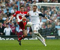 Photo: Chris Ratcliffe.<br /> Middlesbrough v West Ham United. The FA Cup, Semi-Final. 23/04/2006.<br /> Dean Ashton of West Ham clashes with Chris Riggott of Middlesbrough.