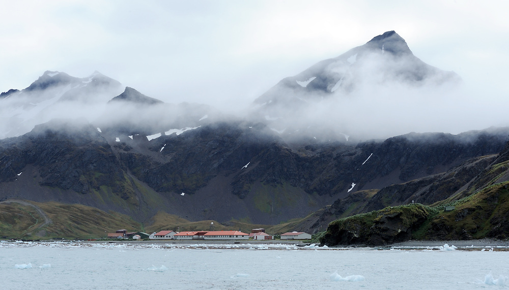 Modern administration and research buildings on King Edward Point with the Norwegian Lutheran Church and  the rusting ruins of the whaling station behind them. Grytviken, South Georgia. 20Feb16
