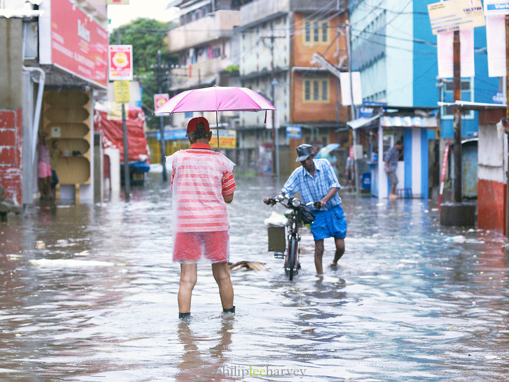 Flooded street scene during the monsoon season, Cochin, Kerala, India