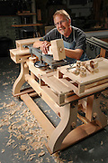 Portrait of brilliant artist of wood Doug Lamont, in his shop with a new creation.