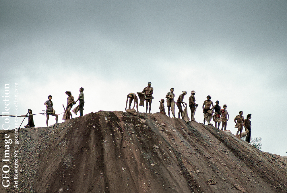 Miners at the top of the Serra Pelada mine dumping gold-less soil.