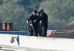 © Licensed to London News Pictures. 19/05/2018. London, UK. Police snipers watch from a rooftop ahead of The wedding of Prince Harry to Meghan Markle at St George's Chapel in Windsor. Photo credit: Ben Cawthra/LNP