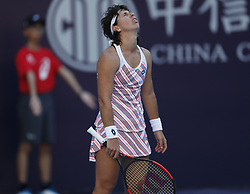 BEIJING , Oct. 2, 2018  Carla Suarez Navarro of Spain reacts during the women's singles second round match against Angelique Kerber of Germany at China Open tennis tournament in Beijing, China, Oct. 2, 2018. Carla Suarez Navarro lost 0-2. (Credit Image: © Jia Haocheng/Xinhua via ZUMA Wire)