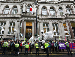 © Licensed to London News Pictures. 16/10/2019. London, UK. Extinction Rebellion march with a large white puppet horse to protest against climate change atthe Japanese Embassy in central London. Activists continue to occupy roads around Westminster for the 10th day as protesters gather in Trafalgar Square to oppose the Police ban. Photo credit: Alex Lentati/LNP