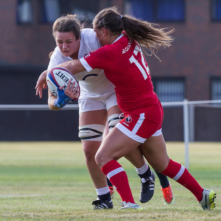 Sally Stott tackled, U20 England Women v U20 Canada Women at Trent College, Derby Road, Long Eaton, England, on 18th August 2016