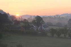 © Licensed to London News Pictures. 30/05/2021. Hundred House, Powys, Wales, UK.  Mist hangs in the valleys at dawn near Hundred House,in Powys, Wales, after an un-seasonal cold night where temperatures dropped to around 4.5 deg C  Wales, UK. Photo credit: Graham M. Lawrence/LNP