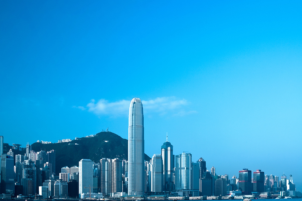 Skyline of Victoria Harbour on Hong Kong Island from Kowloon, China, Asia