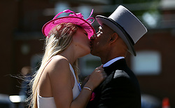 Racegoers enjoy a kiss during day three of Royal Ascot at Ascot Racecourse. PRESS ASSOCIATION Photo. Picture date: Thursday June 21, 2018. See PA story RACING Ascot. Photo credit should read: Nigel French/PA Wire. RESTRICTIONS: Use subject to restrictions. Editorial use only, no commercial or promotional use. No private sales.