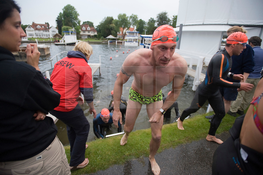 © Licensed to London News Pictures. 26/06/2011. Henley-on-Thames, UK. Competitor leaving the water at the finnish. Swimmers take part in the Henley Swim at dawn this morning (26/06/2011). The annual event sees competitors swim the length of the 2.1km course of the Henley Royal Regatta on the River Thames, after arriving in darkness, and walking half a mile to the start at sunrise. See special instructions. Photo credit should read: Ben Cawthra/LNP