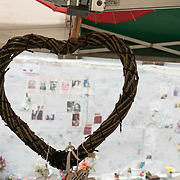 London, England, UK. 27th July 2017. Ten of thousands of Messages written by people, posters and flowers pay respect and remembrance of the Grenfell Tower fire victims at Latimer Road.