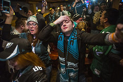 February 4, 2018 - Minneapolis, MN, USA - Husband and wife Samantha and Charlie Hubbs almost could not take all the drama at the end of the game at the Blarney Pub and Grill during Super Bowl LII on Sunday, Feb. 4, 2018, in Minneapolis, Minn. The Philadelphia Eagles defeated the New England Patriots, 41-33. (Credit Image: © Richard Tsong-Taatarii/TNS via ZUMA Wire)