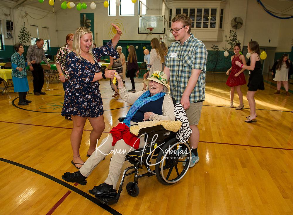 Lexys Bladecki, Zack McAllister and Rita Garrett join on the dance floor at the Laconia Community Center for the Senior Senior Dance put on by the Laconia High School seniors.  (Karen Bobotas/for the Laconia Daily Sun)
