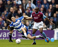 Photo: Richard Lane.<br /> Reading v West Ham United. Nationwide Division One. 03/04/2004.<br /> James Harper is challenged by Nigel Reo-Coker.