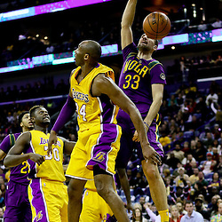 Feb 4, 2016; New Orleans, LA, USA; New Orleans Pelicans forward Ryan Anderson (33) dunks over Los Angeles Lakers forward Kobe Bryant (24) during the fourth quarter of a game at the Smoothie King Center. The Lakers defeated the Pelicans 99-96. Mandatory Credit: Derick E. Hingle-USA TODAY Sports