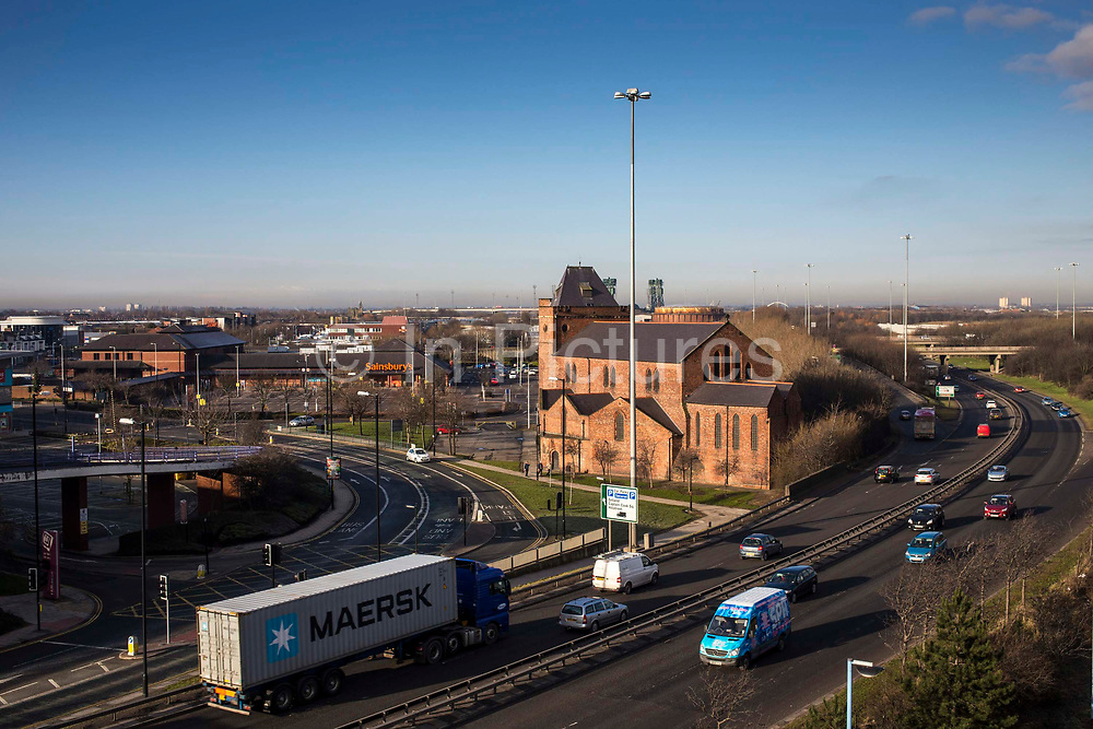 A Maersk container on th e back of a flatbed lorry travels along the A66, a dual carridge way through Middlesborough.