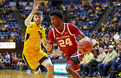 Feb 2, 2019; Morgantown, WV, USA; Oklahoma Sooners guard Jamal Bieniemy (24) drives baseline during the first half against the West Virginia Mountaineers at WVU Coliseum. Mandatory Credit: Ben Queen-USA TODAY Sports