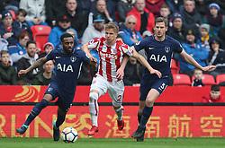 Stoke City's Moritz Bauer (centre) battles for the ball with Tottenham Hotspur's Danny Rose (left) and Jan Vertonghen (right)