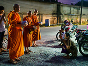 13 JANUARY 2019 - NAKHON PATHOM, THAILAND: Female monks from Wat Songdhammakalyani chant after women in the community gave the monks food on their alms rounds. The Sangha Supreme Council, Thailand's governing body of Buddhist monks, bans the ordination of female monks, but hundreds of Thai women have gone abroad, mostly to Sri Lanka and India, to be ordained. There are about 270 women monks in Thailand and about 250,000 male monks. There are 7 monks and 6 novices at Wat Songdhammakalyani in Nakhon Pathom. It was the first temple in Thailand to have female monks. The temple opened 60 years ago and has always been a temple of women monks. Women can be ordained as novices in Thailand, but to be ordained as a full monk would require the participation of 10 female monks and 10 male monks, and male monks in Thailand are barred from participating in women's ordination ceremonies.     PHOTO BY JACK KURTZ