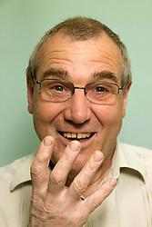 Portrait of an older man gesturing,