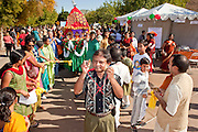 Nov. 22, 2009 -- PHOENIX, AZ: Indian-Americans haul a cart bearing deities  during the annual Discover India Festival in Phoenix, AZ. This is the 8th year the Indian Association of Phoenix has sponsored the festival, which started as a celebration of Diwali, the Indian Festival of Lights, and has since grown to be a celebration of India's cultures, traditions and diversity.    Photo by Jack Kurtz