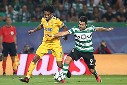 October 31, 2017 - Lisbon, Portugal - Juventus' Colombian forward Juan Cuadrado (L) fights for the ball with Sporting's midfielder Marcos Acuna from Argentina during the UEFA Champions League football match Sporting CP vs Juventus at the Alvalade stadium in Lisbon, Portugal on October 31, 2017. (Credit Image: © Pedro Fiuza/NurPhoto via ZUMA Press)
