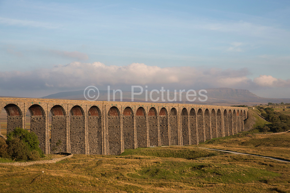 Ribblehead Viaduct or Batty Moss Viaduct carries the Settle-Carlisle Railway across valley of the River Ribble at Ribblehead, in North Yorkshire Dales, England, UK. This impressive Victorian architectural wonder was designed by engineer, John Sydney Crossley and was built between 1870 and 1874. Pen-y-ghent can be seen in the distance.