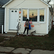 Feng Chun Tan attempts to deliver bread to her neighbors in Keansburg, NJ. She visited door-to-door, but most people had evacuated or left there homes after the flooding casued by Superstorm Sandy, The storm-surge from Superstorm Sandy destroyed several oceanfront blocks of Keansburg, including residences, and an amusement park.