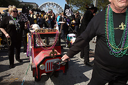 07 February 2010. New Orleans, Louisiana, USA. <br /> The 'Barkus' parade sets off with Saints mania clearly the flavour of the day for New Orleans' only dog Mardi Gras parade. Saints fans gather in the French Quarter in anticipation of the big game in Miami later in the day as the home team goes head to head with the Indianapolis Colts for Superbowl 44. <br /> Photo ©; Charlie Varley/varleypix.com