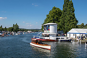 """Henley on Thames, United Kingdom, 8th July 2018, Sunday, View,  """"The Genevieve"""", """"Beaver Stern Saloon Launch"""", manovering' """"at the side of the Floating Grandstand"""",  """"Fifth day"""", of the annual,  """"Henley Royal Regatta"""", Henley Reach, River Thames, Thames Valley, England, © Peter SPURRIER,"""