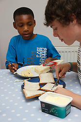 Teenagers making cheese sandwiches