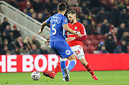 Middlesbrough midfielder Lewis Wing (26) plays the ball ahead of Peterborough United defender Ryan Tafazolli (5) during The FA Cup 3rd round match between Middlesbrough and Peterborough United at the Riverside Stadium, Middlesbrough, England on 5 January 2019.