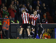 Stefan Scougall of Sheffield Utd replaces Mark Duffy of Sheffield Utd during the English League One match at Bramall Lane Stadium, Sheffield. Picture date: December 10th, 2016. Pic Simon Bellis/Sportimage
