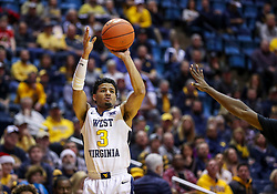 Dec 22, 2018; Morgantown, WV, USA; West Virginia Mountaineers guard James Bolden (3) shoots a three pointer during the second half against the Jacksonville State Gamecocks at WVU Coliseum. Mandatory Credit: Ben Queen-USA TODAY Sports