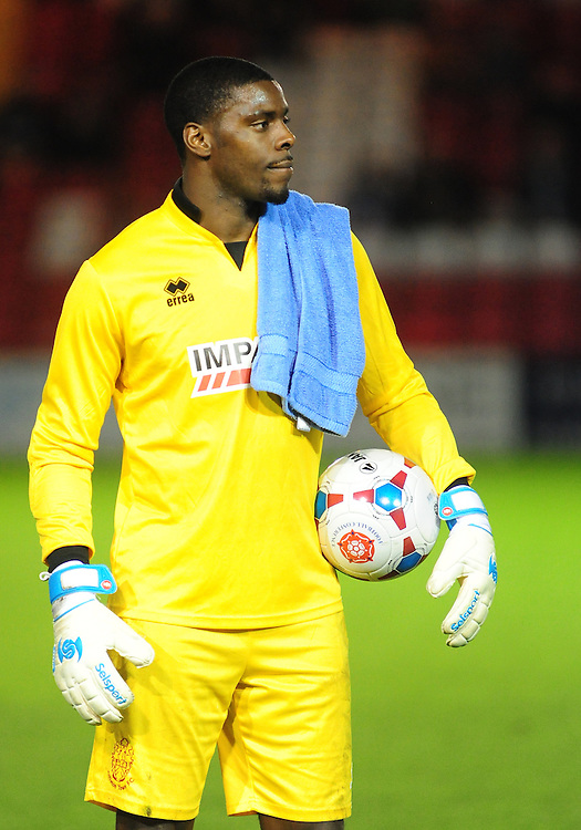 Alfreton Town's Anthony Howell before kick off.  Midfielder Howell was forced to play in goal for the FA Cup Fourth Qualifying round replay.<br /> <br /> Photo by Chris Vaughan/CameraSport<br /> <br /> Football - FA Challenge Cup Fourth Qualifying Round replay - Lincoln City v Alfreton Town - Tuesday 28th October 2014 - Sincil Bank - Lincoln<br /> <br /> © CameraSport - 43 Linden Ave. Countesthorpe. Leicester. England. LE8 5PG - Tel: +44 (0) 116 277 4147 - admin@camerasport.com - www.camerasport.com
