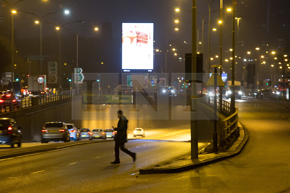 © Licensed to London News Pictures. 18/12/2017. Birmingham, UK. The scene this morning in Lea Bank Underpass, Edgbaston, where six people lost their lives in a road traffic accident.  Pictured, the underpass was opened for early Monday morning traffic as one pedestrian dodges the traffic to cross the road. Photo credit: Dave Warren/LNP