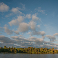 Clouds drift over an island in Lake of the Woods, near Kenora, Ontario, Canada.
