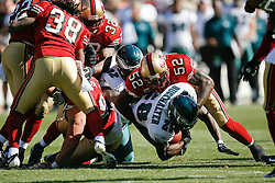 12 Oct 2008: Philadelphia Eagles running back Correll Buckhalter #28 is brought down by linebacker Patrick Willis #52t during the game against the San Francisco 49ers on October 12th, 2008. The Eagles won 40-26 at Candlestick Park in San Francisco, California. (Photo by Brian Garfinkel) (Photo by Brian Garfinkel)