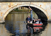 © Licensed to London News Pictures. 01/03/2012, Cambridge, UK. People punting. People enjoy the sunshine on the River Cam in the grounds of  The University of Cambridge today, 1st March 2012. Photo credit : Stephen Simpson/LNP