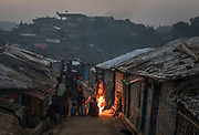 A group of children warm up by a fire during early morning hours in the Balukhali refugee camp in Cox's Bazar, Bangladesh, December 3, 2019. For the past 40 years, Bangladesh has provided shelter to Rohingya refugees from Myanmar following five separate outbreaks of violence and persecution. Prior to the most recent outbreak of violence in 2017, close to 200,000 Rohingya refugees already lived in Cox's Bazar District. This placed additional pressure on the already fragile social and economic structure of Cox's Bazar, one of the worst performing districts in Bangladesh in almost all child-related indicators and one of the most vulnerable to disasters and climate change. The latest violence and persecution against Rohingya erupted on 25 August 2017, prompting 740,000 Rohingya refugees to flee their homes in Myanmar and seek safety in Bangladesh. There are now close to one million Rohingya refugees living in crowded congested camps in Cox's Bazar. Women and children comprise 80 per cent of the population, over 500,000 are children under the age of 18.