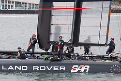 © Licensed to London News Pictures. 15/07/2016. Portsmouth, United Kingdom.  Team Land Rover BAR (Ben Ainslie Racing) heading out of Portsmouth Harbour for training in the Solent this morning, 15th July 2016. The team are currently preparing for the America's Cup World Series (ACWS) event being held in Portsmouth between 22-24th July 2016. Photo credit: Rob Arnold/LNP