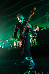 © Licensed to London News Pictures. 24/07/2013. London, UK.   Flea of Atoms for Peace performing live at The Roundhouse. Atoms For Peace is an experimental rock & electronic supergroup formed in late 2009 in Los Angeles, California. The group consists of Radiohead lead singer Thom Yorke (vocals, guitar, and piano), Red Hot Chili Peppers bassist Flea, longtime Radiohead producer Nigel Godrich (keyboards, synths, guitars), Joey Waronker of Beck & R.E.M. (drums) and Brazilian instrumentalist Mauro Refosco (percussion) of Forro in the Dark. Their debut album, Amok, was released on February 25, 2013.   Photo credit : Richard Isaac/LNP