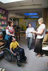 Speech therapist visiting special school,