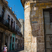 Elderly Cuban walking on Habana Street in Old Havana